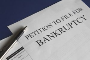 What are the major benefits of filing for bankruptcy?
